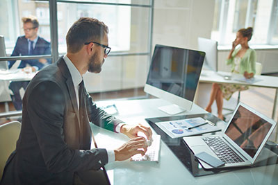 Photo of Man working at desk